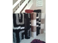 black white grey brown cream red and black shaggy plain and pattern rugs