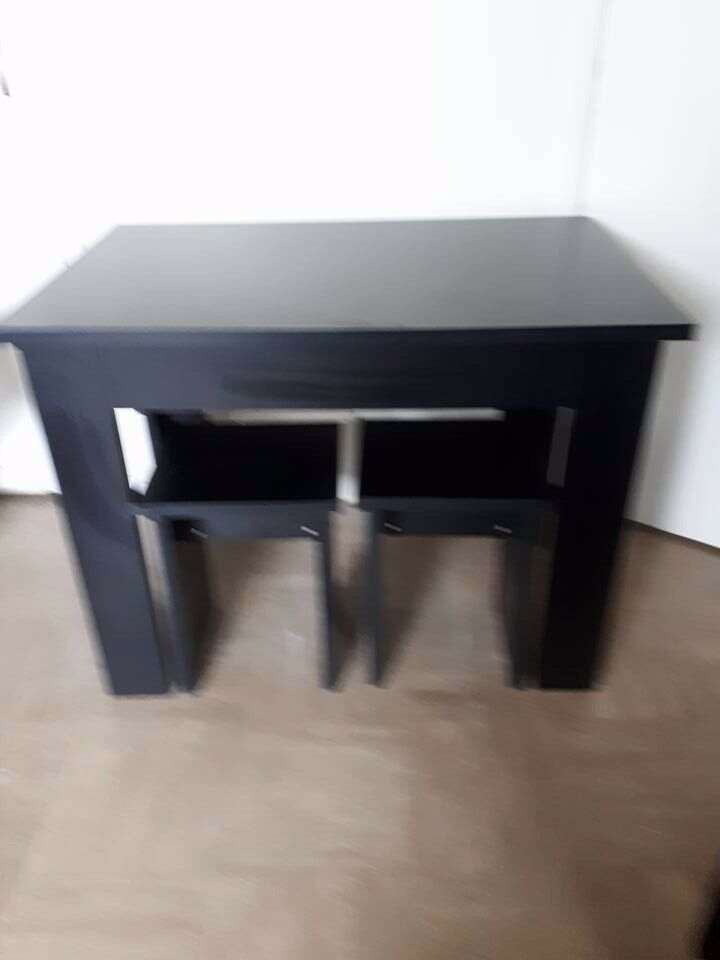 black table and 4 stools