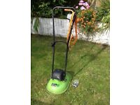 Lawn mower with spare plastic blades.