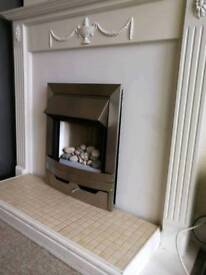 White fireplace in good condition size 1.22longx1.05high and bottom depth 0.41.