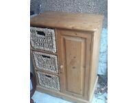 Natural pine dresser with shelves and rattan baskets