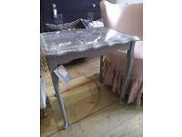 Gray side Table with glass top.