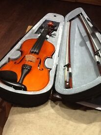 Violin -- hardley used