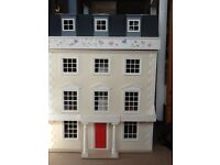 Victorian Doll's House with wooden family and wooden furniture