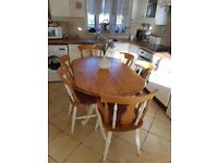 SOLID PINE SHABBIED TABLE AND SIX CHAIRS ,, INC TWO CARVERS. FIVE FEET LONG AND THREE FEET WIDE.