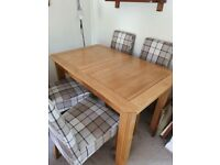 Solid Oak extending dining table + 6 upholstered chairs