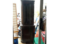 Corner Cabinet 6 feet tall lockable. Good condition. Movable shelves.