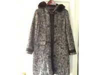 Ladies black and white winter warm winter coat with zip and toggle fastening