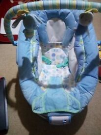 Baby bouncer with music and vibration option, used few days and very good condition