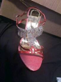 Red sandals with diamante strap