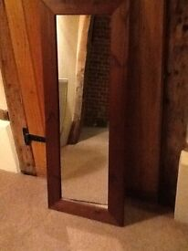 Dark wooden mirror