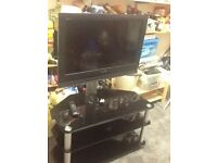 """32"""" flat screen television and stand"""