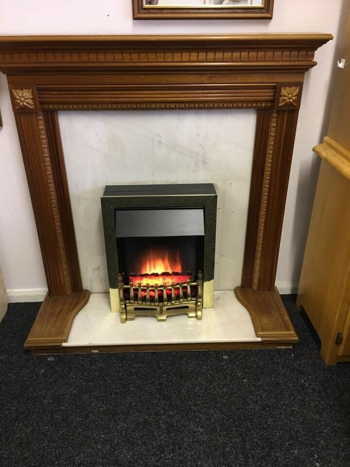 Freestanding surround and solid marble and electric fire can deliver most areas
