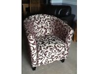 Good condition tub chair for sale - beige with dark purple contemporary pattern