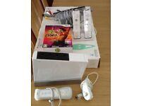 Wii console + board and accessories. Excellent condition.
