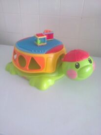 Fisher-Price Peek a Blocks Build & Spill Musical Turtle has 2 shapes out of 3
