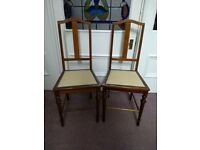 Pair of Vintage Mahogany chairs with turned legs.