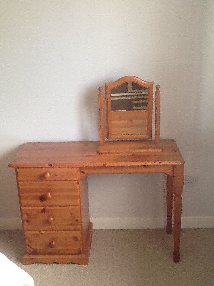 A Pine Dressing Table with 4 drawers and a mirror.