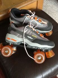 Quad roller skates on Sketchers style boots. Barely used,heel and toe brakes. Size 7.