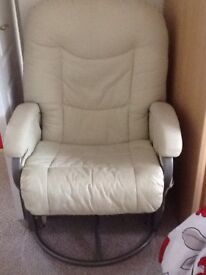 Swivel chair cream in colour. In very good condition. From pet and smoke free home.