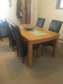 Large Chunky Dining Table with frosted glass, 4 black leather look chairs, large matching sideboard