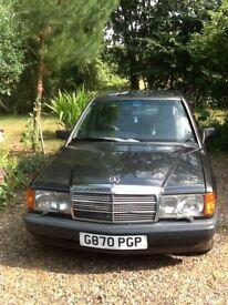 Mercedes 190E £2,599 ono - good condition, no rust - 1990 4 dr black auto grey leather interior