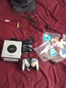 GameCube with controller and games