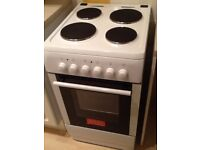 Freestanding white electric cooker with oven, grill & 4 ring hob. Never used.