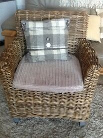 Basket weave chair with cushion pad