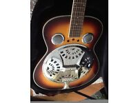 Rally Guitar in plush case. Lovely vibrator style wood and metal