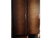 2 quirky leopard print bathroom cabinets, for sale at £60 for the pair.