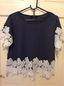 Navy short sleeved top with white floral lace, size 8.