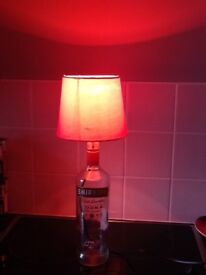 Up cycled smirnoff vodka bottle with red bulb and lamp