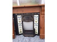 Vintage style fire surround and cast iron insert.