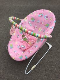Pink baby bouncer