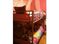 Metal bunk bed frame with pink panels