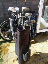golf equipment, with balls, bag. clubs all set.