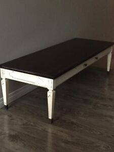 Solid Wood Coffee Table with metal tipped legs.