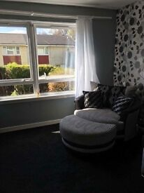 Corner sofa with a swivel snuggle chair still in as new condition.