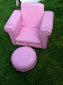 Pink child's chair with footstool