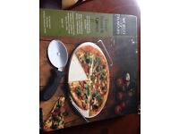 Kitchencraft World of Flavours pizza stone and cutter