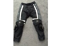 RST leather motorbike trousers