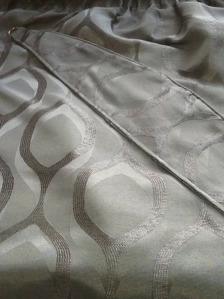 Lined grey curtains with tie-backs