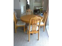 Solid Wood dining table and four matching chairs