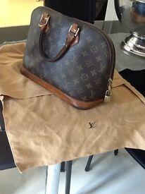 Genuine designer Louis Vuitton handbag ,genuine leather
