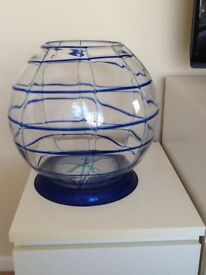 Large glass fish bowl with blue pattern and stand