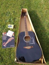 Brand-new acoustic guitar plus accessories