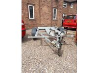 Benderup adjustable double to single bike trailer. Comes with spare wheel. Works as it should
