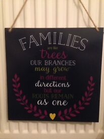 Hanging wooden plaque with family quotes