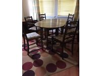 Oak drop leaf dining table and 6 chairs. Excellent condition. Collection only